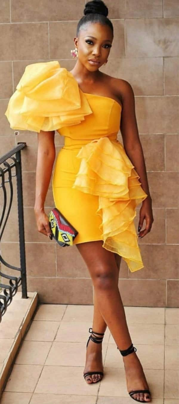 Short gown with one bare shoulder and frills