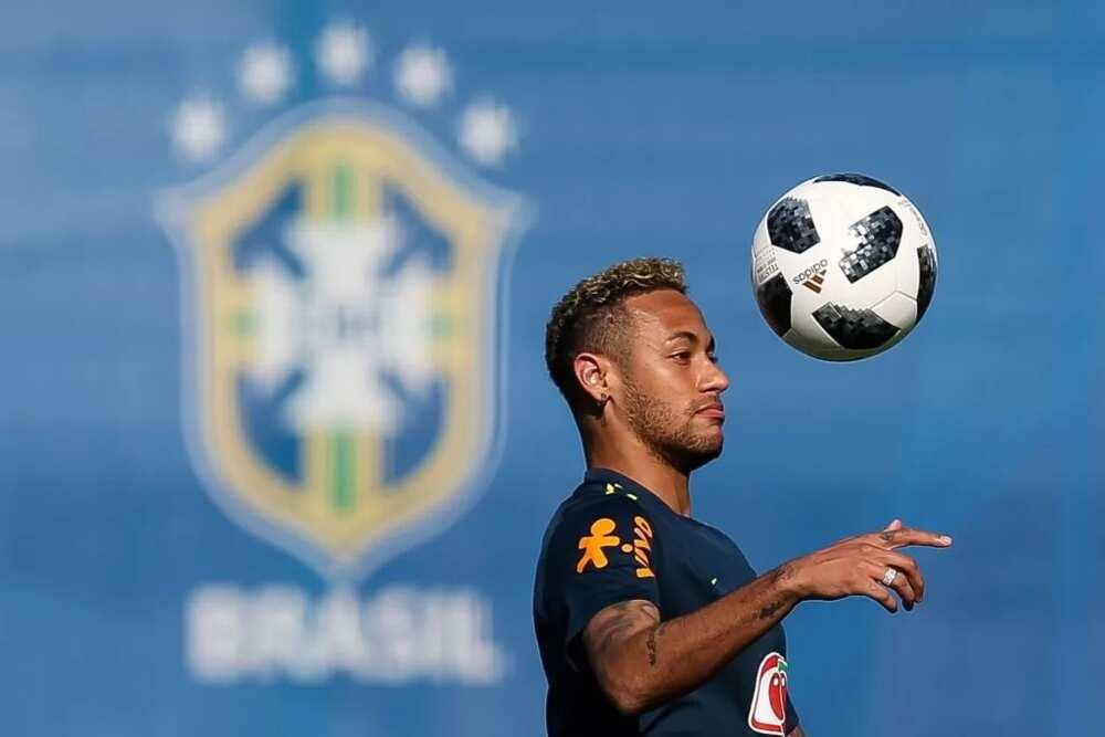 Neymar plays around during Brazil training ahead of Serbia game