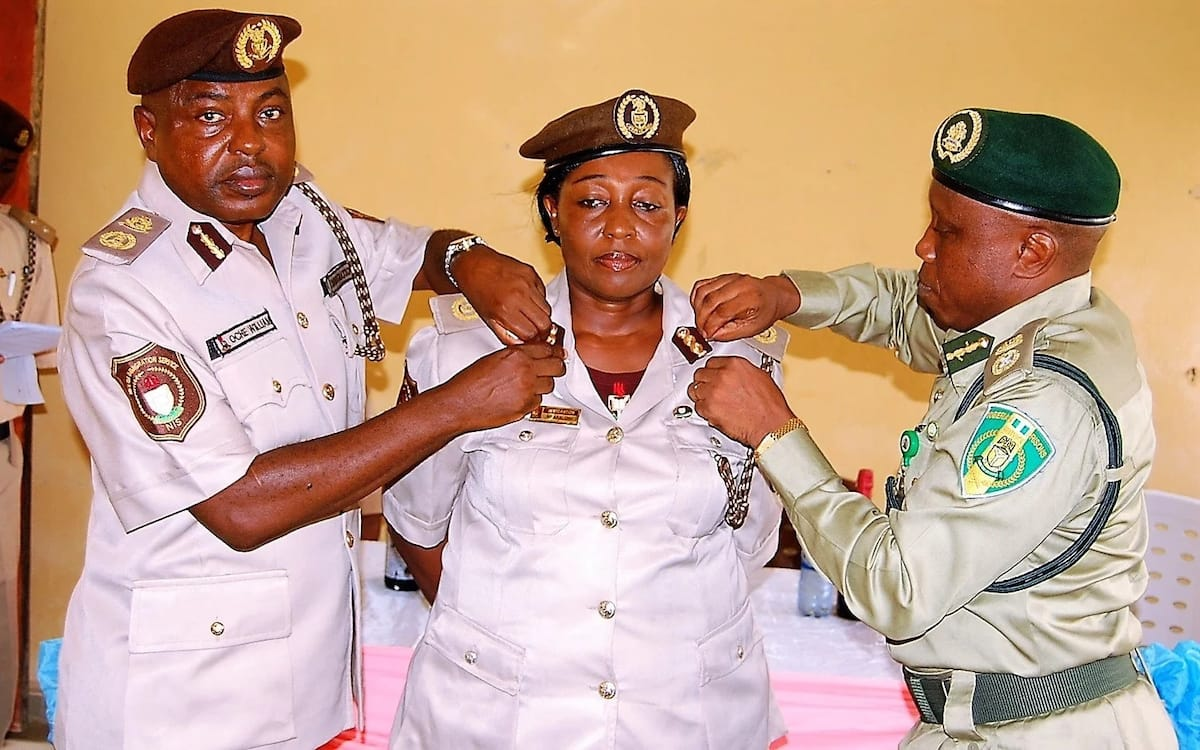 Decoration of an Immigration officer after her promotion