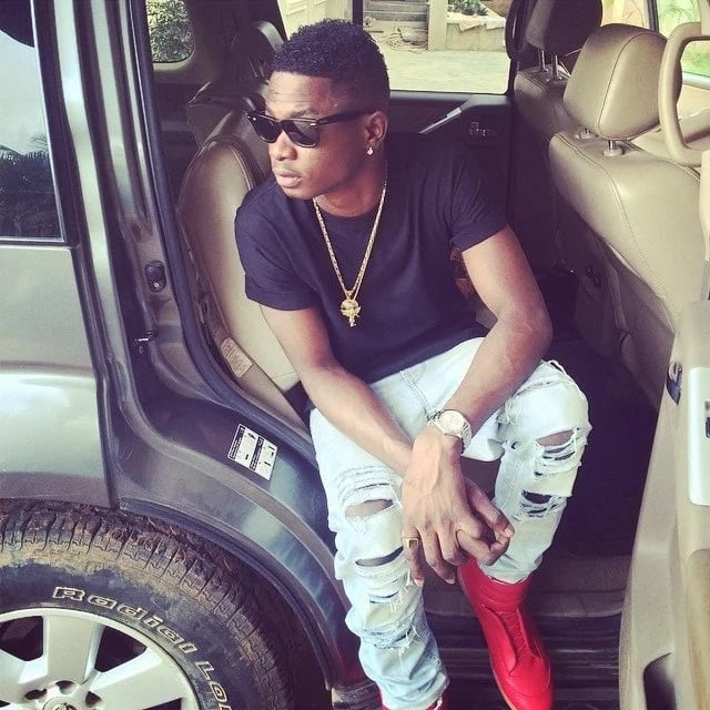 Lil Kesh in a car