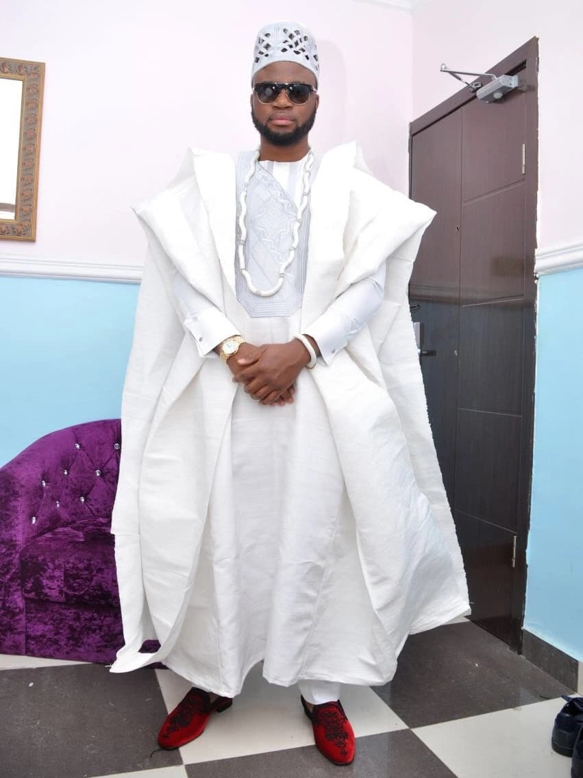 White Agbada style for guys with volume in the shoulder line