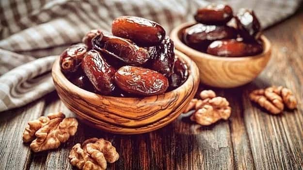 Dates and nuts in bowls