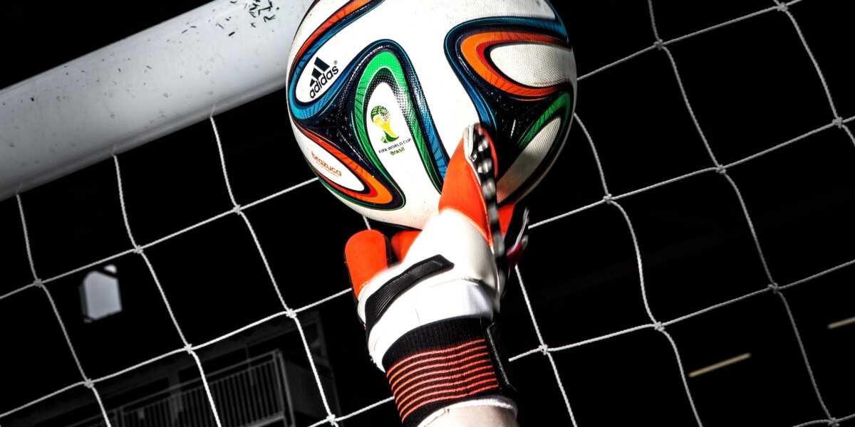 Goalkeeper hand catching ball