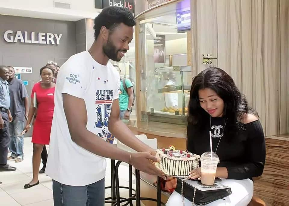 Nigerian man surprises wife publicly presents her with a special kind of 'assurance' on her birthday