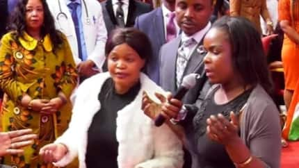 Watch video of woman fighting her best friend in church after pastor's revelation (photos)