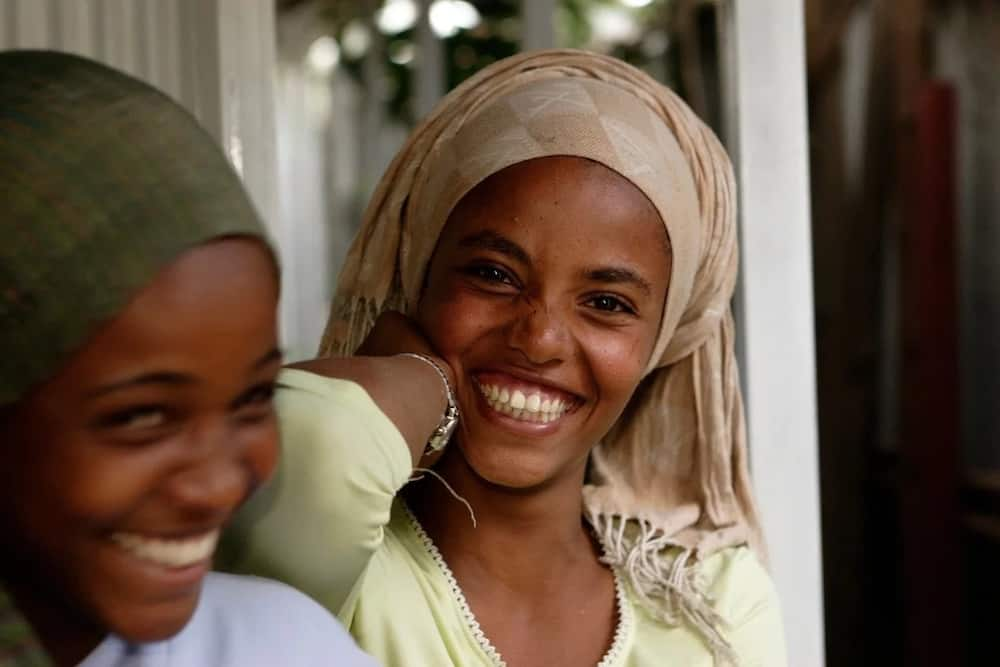 Nigerian women laughing