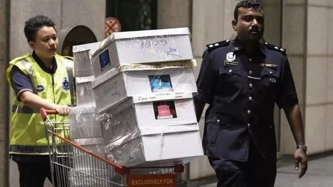 Police seize cash and luxury goods from property of former Malaysian PM