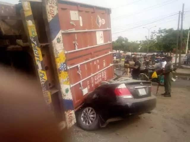 Two escape death as container falls on cars at Apapa Tin-Can