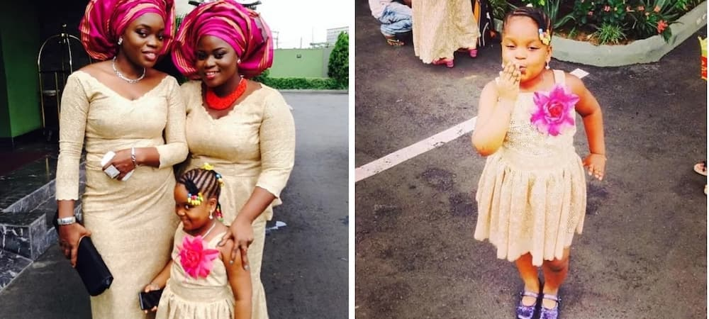 Bisola Aiyeola and daughter in dresses