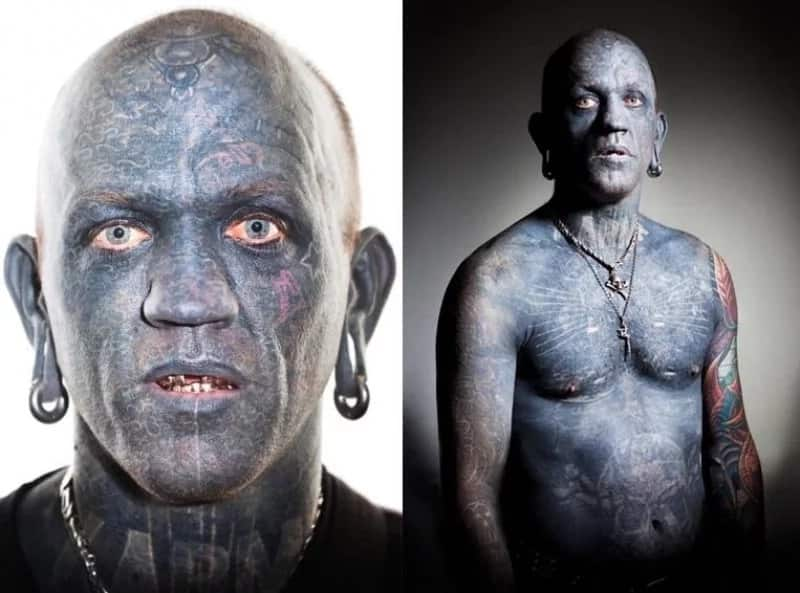 man covered with tattoos