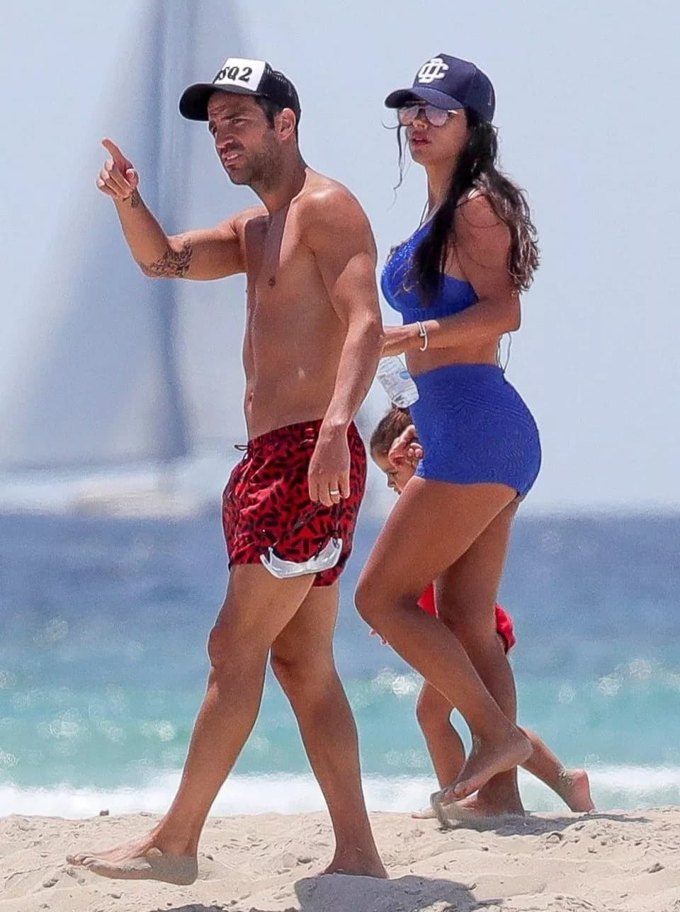 Fabregas caught relaxing with his wife on the beach after World Cup blackout (Photos)