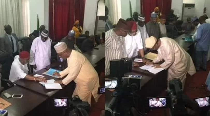 Two front-line aspirants, High Chief Raymond Dokpesi (left) and Gbenga Daniel (right) signing peace accord. Photo credit: PDP