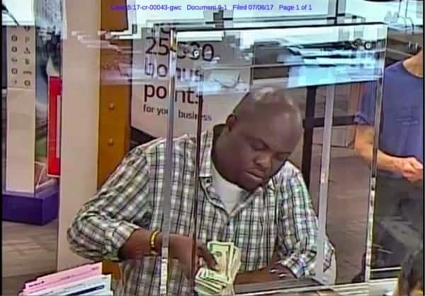 Eneye Dania caught on camera making payment to accomplice Isibor's account in US bank. Photo source: NAN