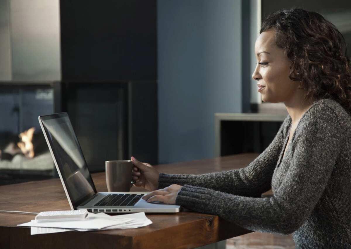Woman paying on laptop