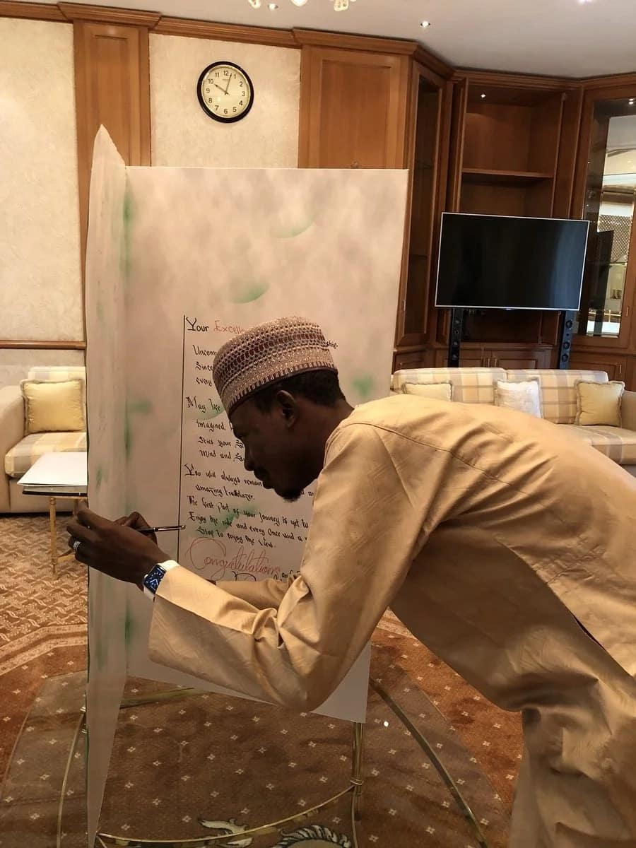 President Buhari honoured at Villa with a giant card as he marks 75th birthday (photos, video)