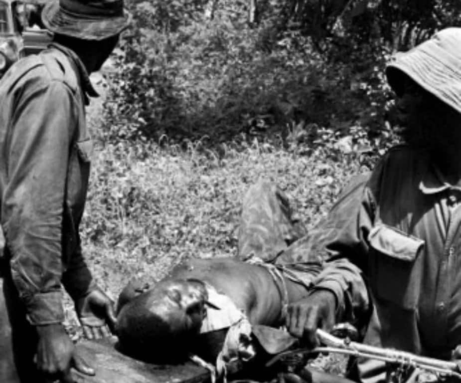 A Nigerian solider wounded in the neck being carried by his comrades