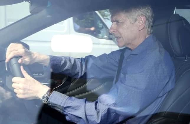 Wenger seen leaving training after making announcement about his future