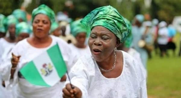 Nigerian woman with a flag