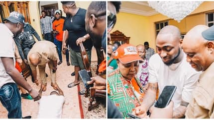 Davido prostrates to greet his uncle Senator Adeleke as they campaign in Osun state (photos)