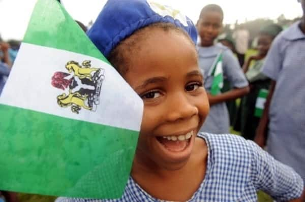 Nigerian kid with a flag