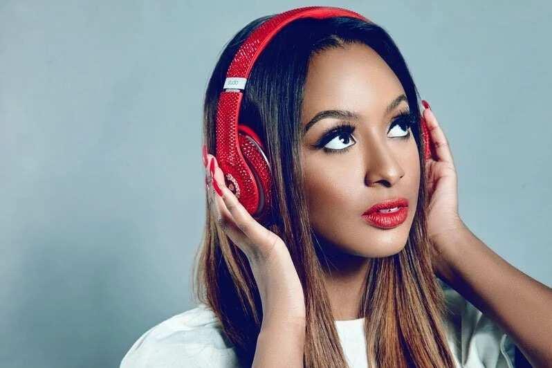 DJ Cuppy in red headphones