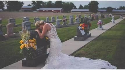 Grieving bride wears her wedding dress as she visits graveside of her fiance who died in an accident on their supposed wedding day (photos)