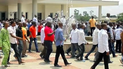 Tension as ex-militants hold staff at Ondo governor's office hostage, many escaped by scaling fence