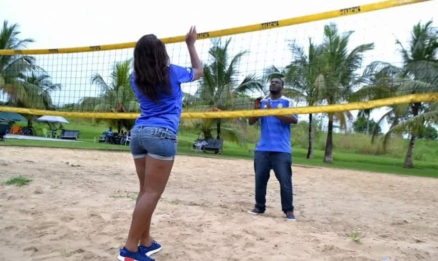 Perpetua and her man playing volleyball Source: Facebook, Perpetua