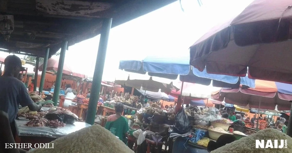 Traders attending to few buyers at Retail Market, Ogba, Lagos. Source: Esther Odili