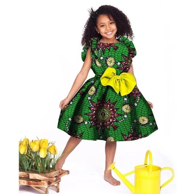 Ankara dress for a girl with the decor (frills and bow)