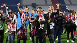 Checkout how Diego Simeone's girlfriend and family rush onto pitch to celebrate with him after Europa League triumph
