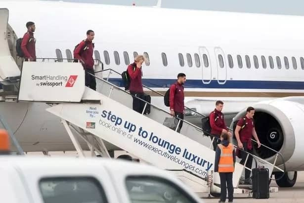 Disappointed Liverpool returned to England in a gloomy atmosphere after Champions League defeat