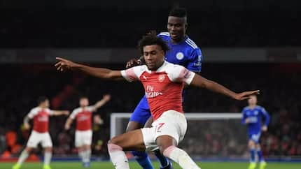 Lovely! Alex Iwobi presents his Man of the Match award to his dad after brilliant performance against Leicester (video)