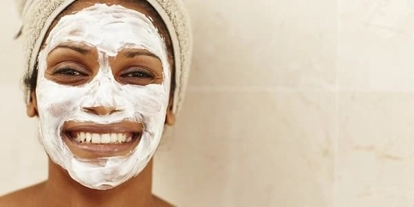 woman with a white face mask