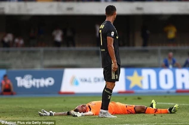 Chievo goalie Sorrentino sustains injury after collision with Ronaldo