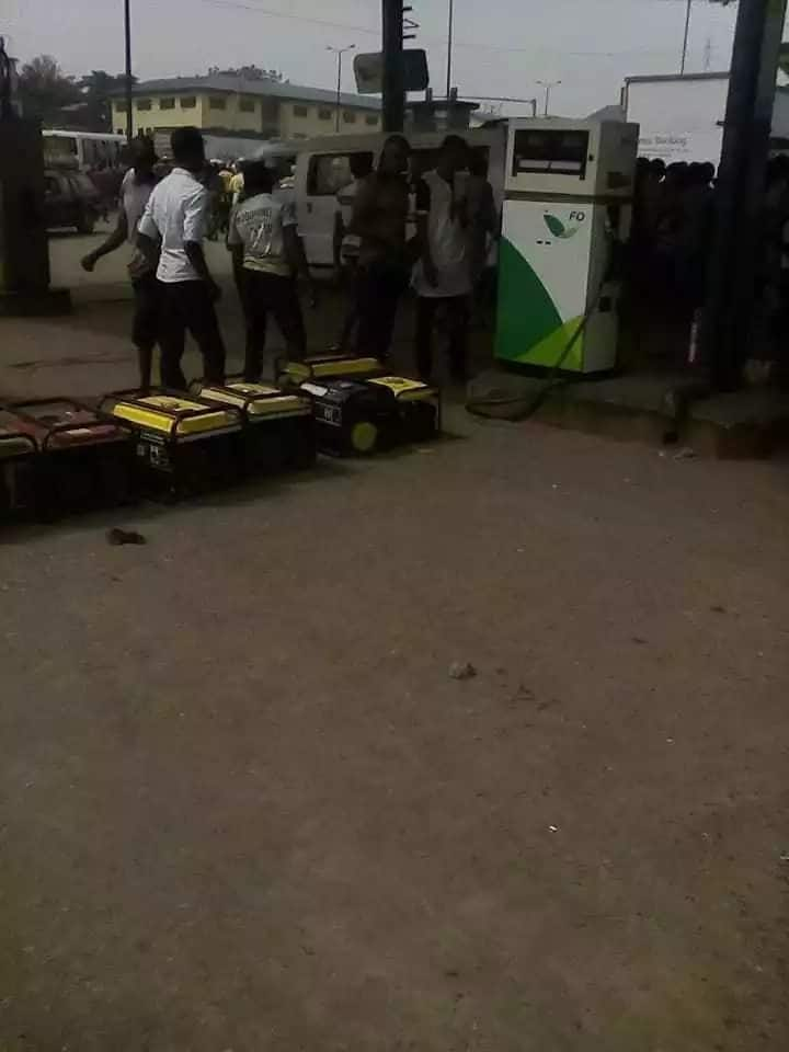 Nigerians queue to buy fuel with generators as scarcity bites harder