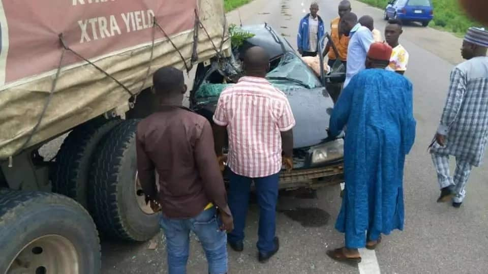 Couple escape unhurt after their car collided with a truck
